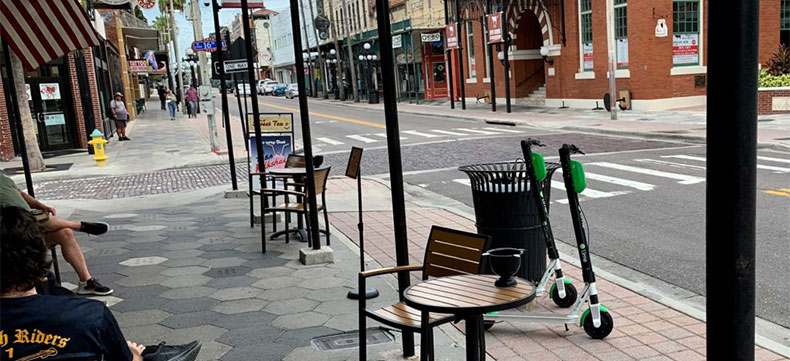 E-scooters are ridden and parked in restricted areas of Ybor City