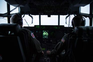 Maj. Kendall Dunn and Lt. Col. Ivan Deroche fly a WC-130J