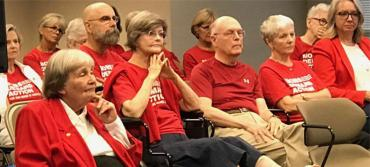 Marion Hammer, left, and supporters at Friday's meeting