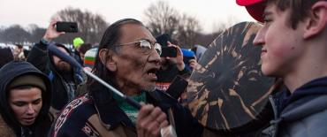 Nathan Phillips and high schooler Nick Sandmann
