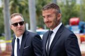 Billionaire Jorge Mas, left, and David Beckham