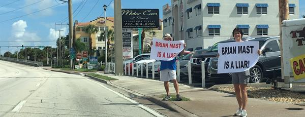 Protestors outside of Brian Mast HQ in Stuart on Saturday, demanding he return donations from Big Sugar